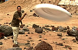 Ashwin Vasavada - planetary scientist at JPL - throws a Frisbee in the mars yard.